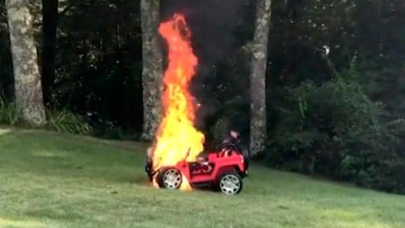 Mother pulls children from toy car just before it bursts into flames