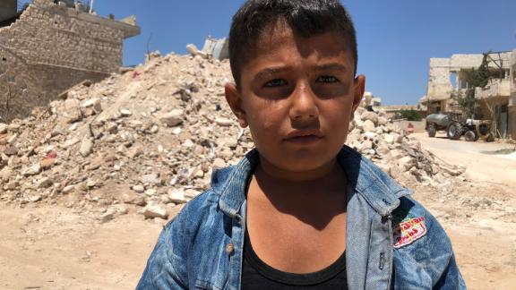 Ibrahim Dervish used to play right outside the ice cream shop with his friends who were killed in the airstrike. The shopkeeper would sometimes give them free ice cream. Ibrahim's favorite is mixed cherry and vanilla in a cone.