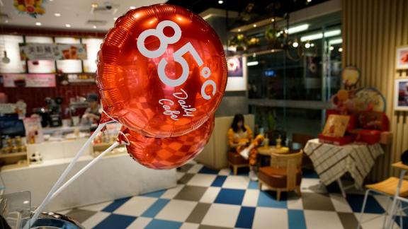 An 85 Degrees C logo is seen inside the shop in Beijing, China, August 17, 2018.