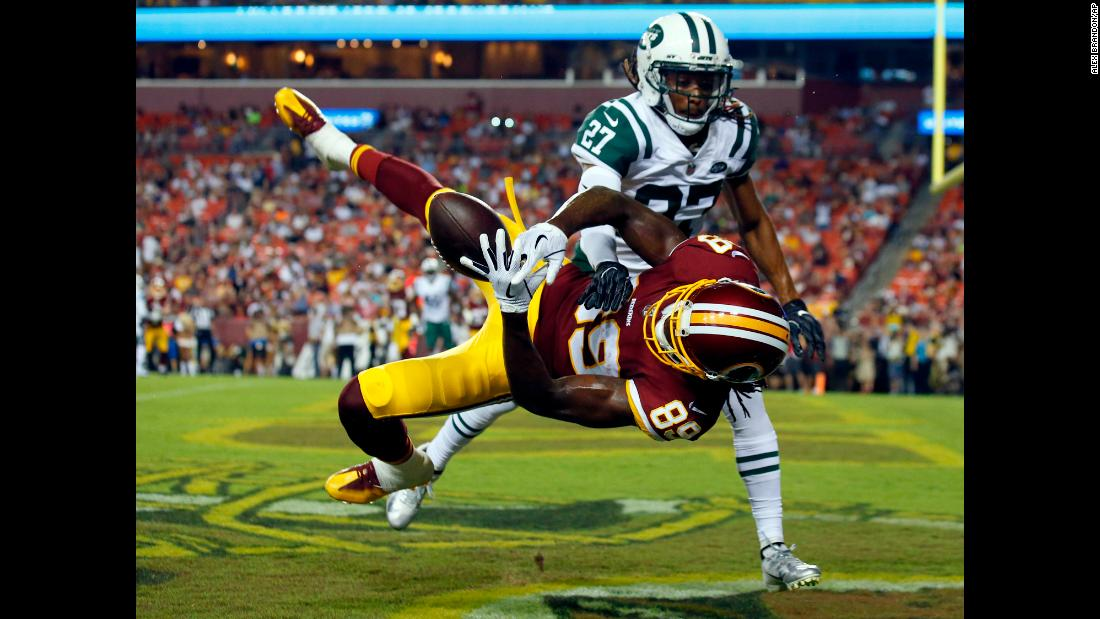 Darryl Roberts of the New York Jets breaks up a pass intended for Cam Sims of the Washington Redskins during the first half of a preseason NFL game on Thursday, August 16, in Landover, Maryland.