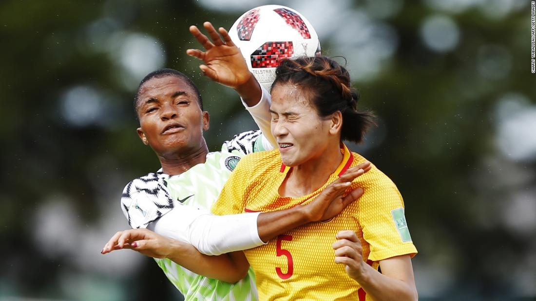 Nigeria's Rasheedat Ajibade vies for the ball with China's Qiaozhu Chen during a Women's World Cup football match on Monday, August 13, in Léhon, France.