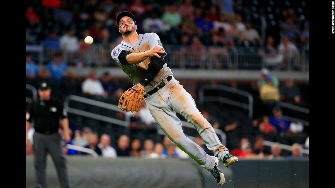 Nolan Arenado of the Colorado Rockies throws to first for an out during the eighth inning of a baseball game against the Atlanta Braves on Thursday, August 16, in Atlanta. The Rockies won 5-3.