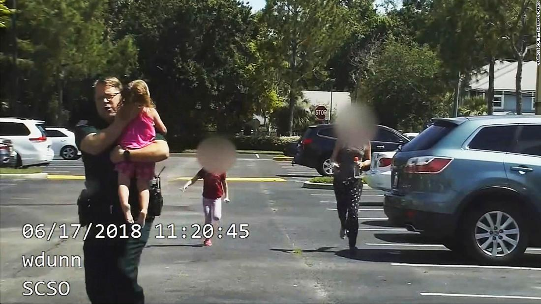 Dashcam shows cop save toddler from hot car