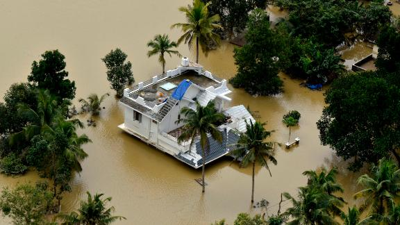 A house is partially submerged in flood waters in Chengannur in the southern state of Kerala, India, Sunday, August 19.
