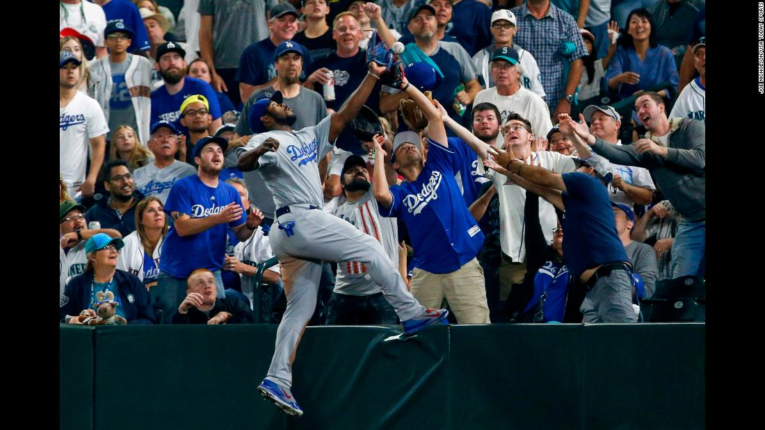 Los Angeles Dodgers right fielder Yasiel Puig fails to catch a foul ball against the Seattle Mariners during the fifth inning of the baseball game in Seattle on Saturday, August 18.