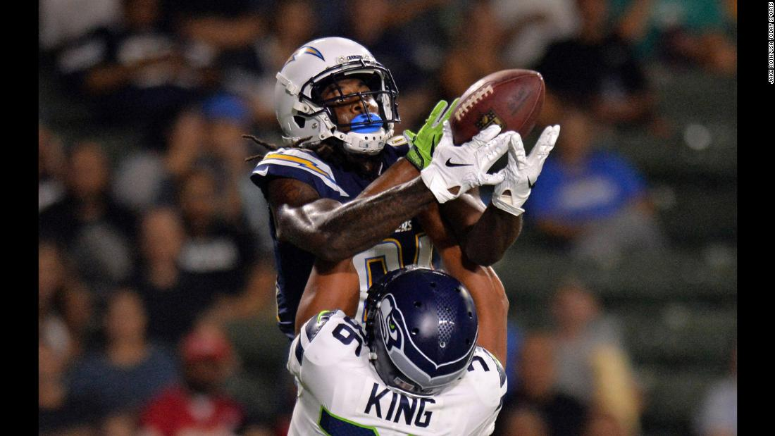 Mike Williams of the Los Angeles Chargers catches a touchdown over Akeem King of the Seattle Seahawks on Thursday, August 18. The Chargers won 24-14.