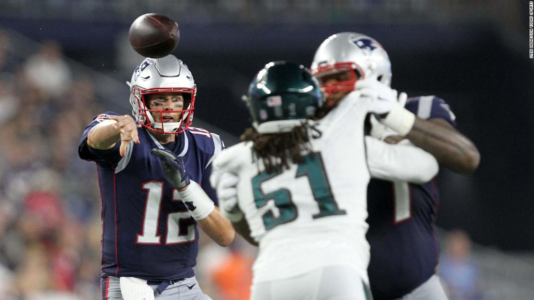 New England Patriots quarterback Tom Brady throws a touchdown pass to running back James White during a preseason NFL game against the Philadelphia Eagles on Thursday, August 16.