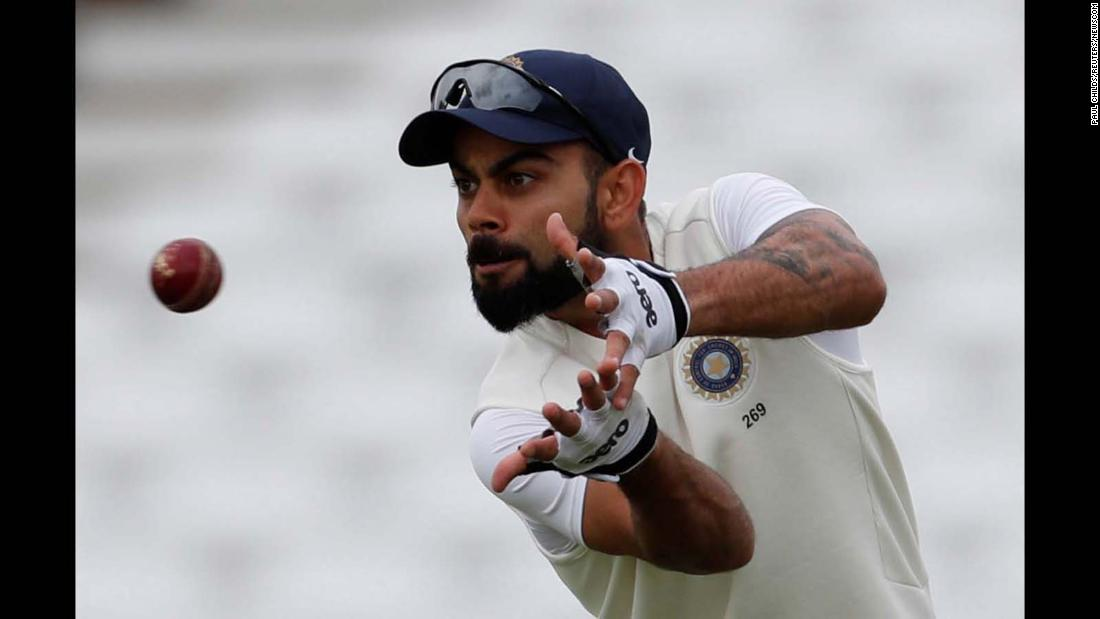 India's Virat Kohli catches the ball during a cricket nets session in Nottingham, England, on Friday, August 17.
