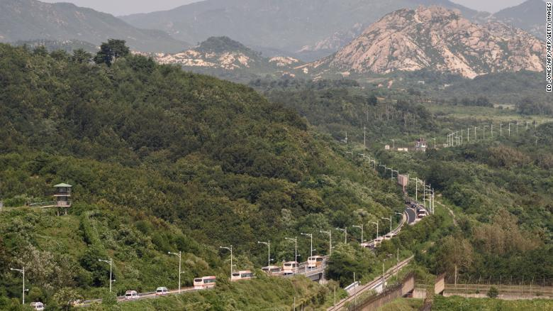 A convoy of buses carrying participants of an inter-Korean family reunion makes its way through the Demilitarized Zone (DMZ) towards North Korea.