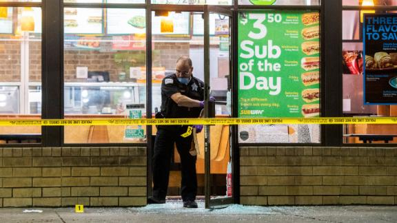 A police officer leaves a Subway after a person was shot Saturday, Aug. 18, 2018, in Chicago. (Tyler LaRiviere/Chicago Sun-Times via AP)
