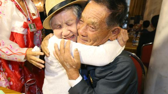 South Korean Lee Keum-seom (L), 92, meets with her North Korean son Ri Sung Chol (R), 71, during a separated family reunion meeting at the Mount Kumgang resort on the North's southeastern coast on August 20, 2018. - Dozens of elderly and frail South Koreans met their Northern relatives on August 20 for the first time since the peninsula and their families were divided by war nearly seven decades ago. (Photo by KOREA POOL / KOREA POOL / AFP) / South Korea OUT / REPUBLIC OF KOREA OUT        (Photo credit should read KOREA POOL/AFP/Getty Images)