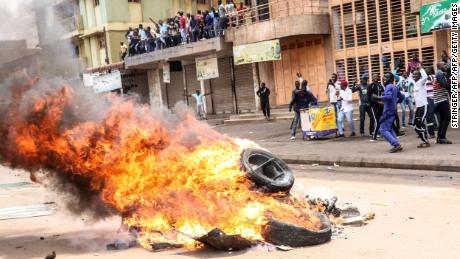 Protesters set a bonfire on a street to demand the release of the Ugandan politician Robert Kyagulanyi in Kampala, Uganda, on Monday.