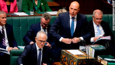 Australia's Minister for Home Affairs Peter Dutton (second right) speaks at Parliament as Australian Prime Minister Malcolm Turnbull (bottom left) looks at his notes on August 20, 2018. (SEAN DAVEY/AFP/Getty Images)