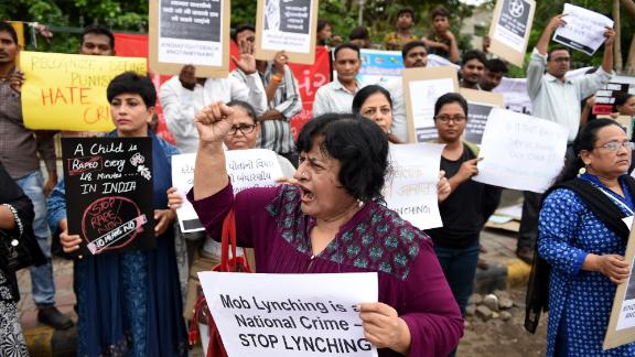 Indians protest against a series of mob lynchings that have been linked to viral hoax messages on WhatsApp