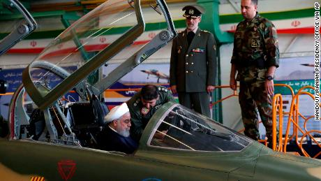 Iranian President Hassan Rouhani sits in the cockpit of the Kowsar fighter jet Tuesday.