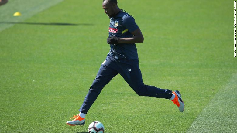 4b28b88cc Usain Bolt kicks the ball during Usain Bolt s first training session with  the Central Coast Mariners