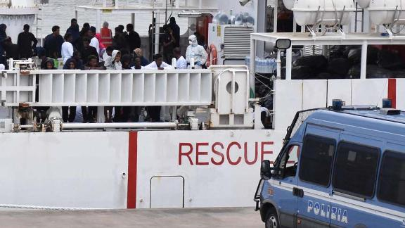 Migrants are seen on board the Italian Coast Guard ship Ubaldo Diciotti moored in the port of Catania in Sicily.