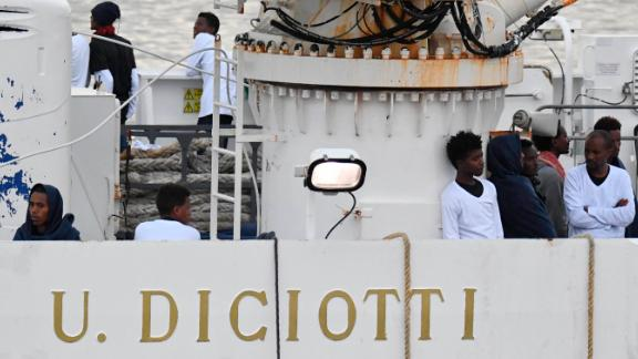One and seventy-seven migrants rescued at sea remained aboard the Italian Coast Guard ship Diciotti Tuesday morning