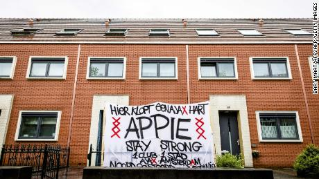 """Here beats a Ajax heart,"" reads a banner in the garden in front of the Nouri house in Amsterdam on July 12, 2017."