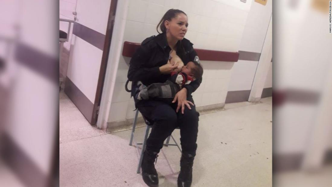 A on-duty police officer calms a crying baby -- by breastfeeding him