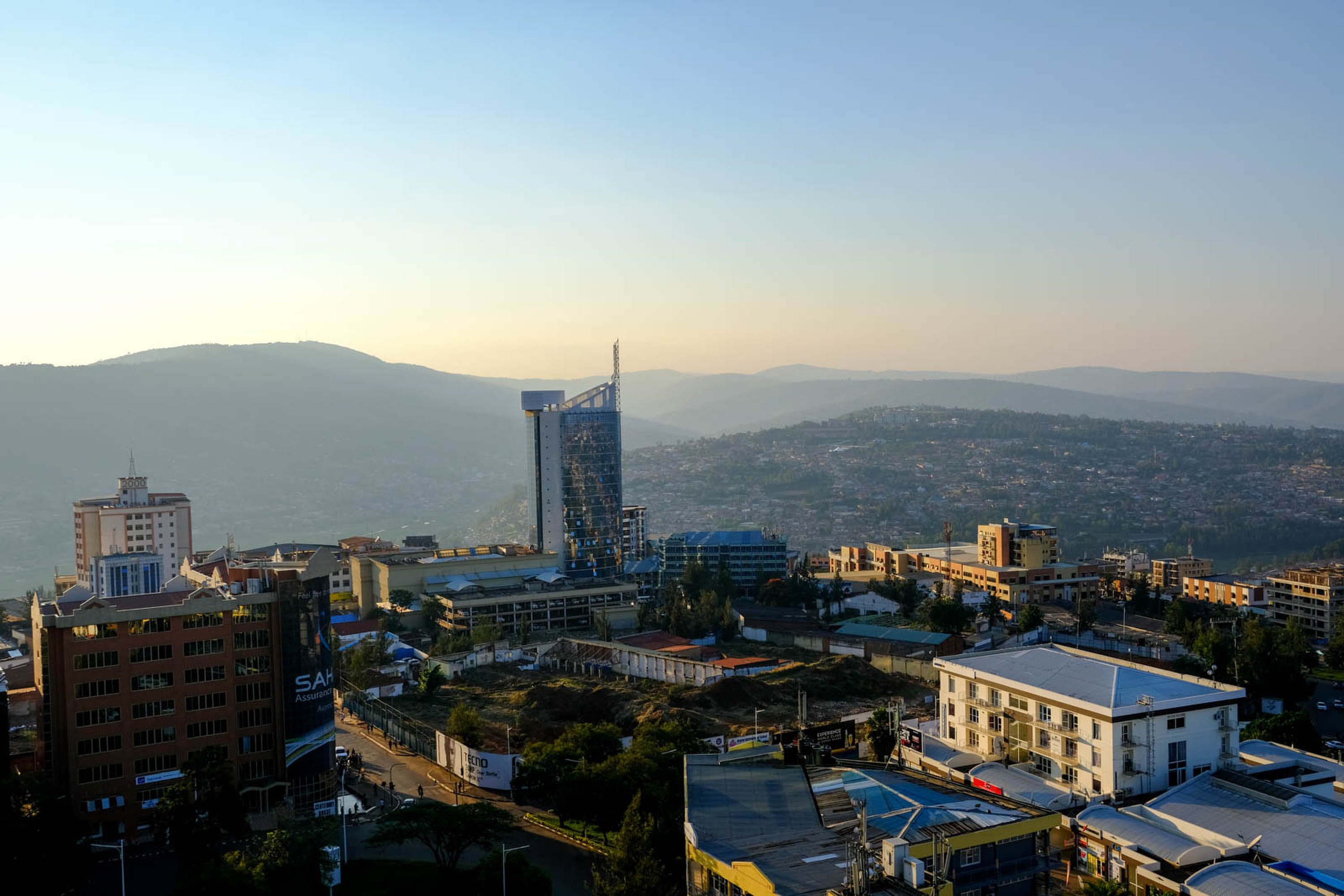 Kigalis expanding skyline. Rwanda has become more financially prosperous and stable under Kagames leadership, but endemic poverty remains an issue nationwide, with around 51% of the population living under the international poverty line.