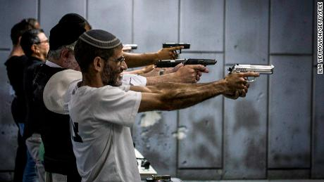Men shoot at a gun range in Jerusalem in October 2015.