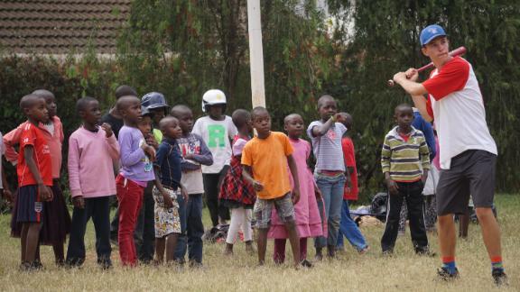 Max Bobholz shows Kenyan children the sport of baseball