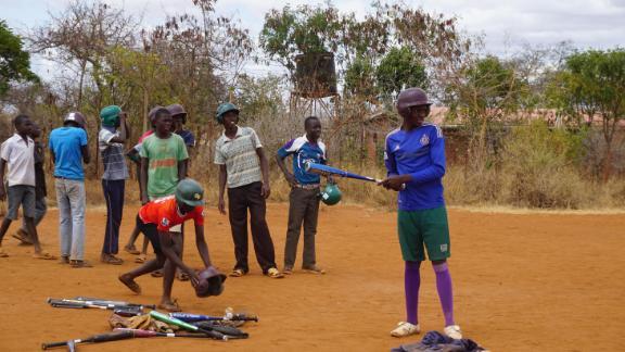 Kenyans watch a game of baseball