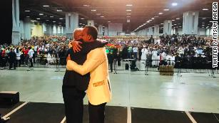 Abiy embraces Tamagn Beyene, an outspoken critic of the previous Ethiopian governments, during his American tour.