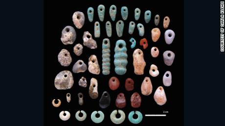 Stone pendants and earrings from the communal cemetery of Lothagam North, Kenya.