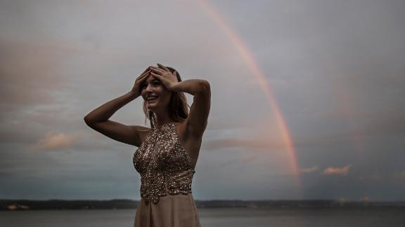 A rainbow appears over the Hudson River shortly after Cara Pressman