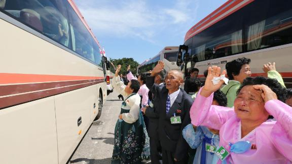 North Koreans wave farewell to their South Korean relatives (in the bus) after a three-day family reunion event at North Korea's Mount Kumgang resort on August 22, 2018. - Elderly North and South Korean family members allowed to meet for the first time in nearly seven decades prepared to bid each other farewell on August 22, in all probability for the last time in their lives. (Photo by KOREA POOL / AFP) / South Korea OUT / REPUBLIC OF KOREA OUT        (Photo credit should read KOREA POOL/AFP/Getty Images)