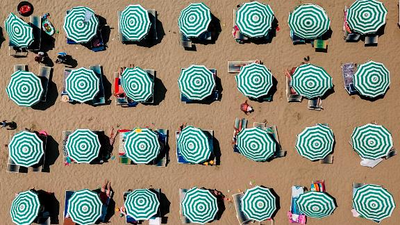 Durrës, Albania: Parasols dot a beach in the port city of Durrës on the Adriatic Sea. Beach-goers made the most of the summer heatwave sweeping Europe and beyond.