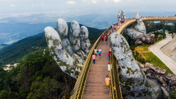 Ba Na Hills, Vietnam: The 150-meter-long Golden Bridge rises above Trường Sơn Mountains. It