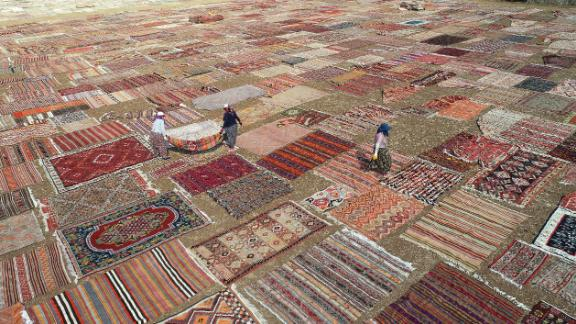 Antalya, Turkey: Hand-knotted carpets are spread out in the sunshine in order to soften the color of their dyes.