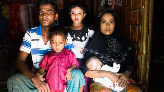 Meher, 25 years old, her baby daughter Yasmin, her son (age 2), her daughter (age 5) and her husband.