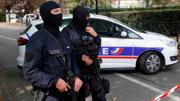 French police officers cordon off the area after a knife attack on Thursday in Trappes.