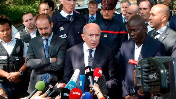 French Interior Minister Gerard Collomb addresses reporters after a knife attack Thursday in Trappes.