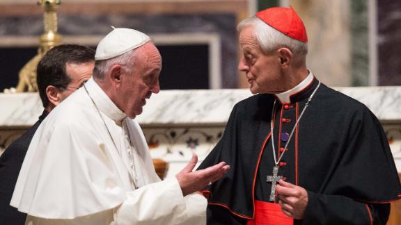 Pope Francis (L) speaks speaks with the Archbishop of Washington Cardinal Donald Wuerl at the end of a midday prayer with US bishops at the Cathedral of St. Matthew the Apostle in Washington, DC, on September 23, 2015 on the second day of his visit to the US.  AFP PHOTO/NICHOLAS KAMM        (Photo credit should read NICHOLAS KAMM/AFP/Getty Images)