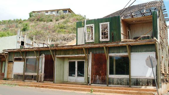 A once-thriving business building in Hanapepe, Kauai stands derelict on Sept. 5, 2002, untouched ten years after its destruction by Hurricane Iniki in 1992.