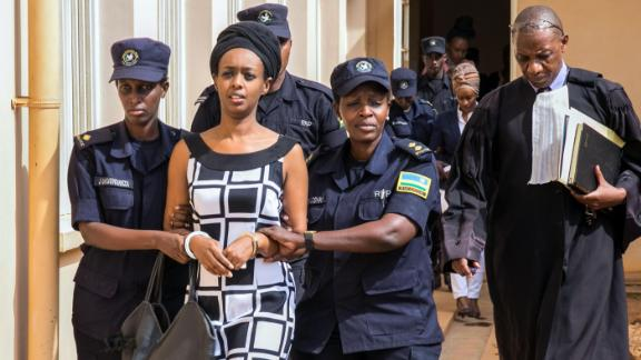 Diane Rwigara (C), a prominent critic of Rwanda's President Paul Kagame, is escorted by Police officers to the court room at the Nyarugenge intermediate court in Kigali on October 9, 2017.  Rwigara was blocked from challenging Kagame in August's presidential election and she had been charged with inciting insurrection against the state as well as other offences. The court is to rule on whether Rwigara, her mother and sister should be held in preventive detention.    / AFP PHOTO / Cyril Ndegeya        (Photo credit should read CYRIL NDEGEYA/AFP/Getty Images)