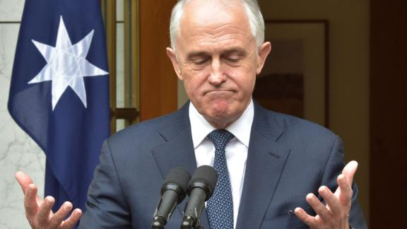 """Australia's Prime Minister Malcolm Turnbull gestures during a press conference at Parliament House in Canberra on August 23, 2018. - Australian Prime Minister Malcolm Turnbull was defiant on August 23 in the face of a new leadership challenge, refusing to """"give in to bullies"""" and vowing to quit politics if he loses a leadership challenge. (Photo by MARK GRAHAM / AFP)        (Photo credit should read MARK GRAHAM/AFP/Getty Images)"""