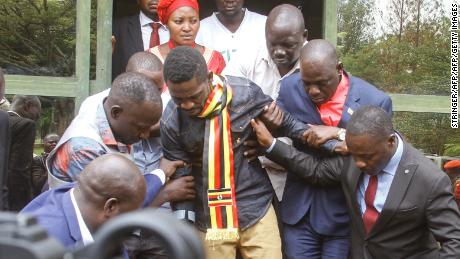 Uganda's prominent opposition politician Robert Kyagulanyi known as Bobi Wine (C) ahead of appearing at the general court martial in Gulu, northern Uganda on August 23, 2018. -