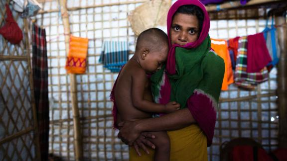 Dildef, 30 years old, with her 2 year old son. She hasn't told her husband she was raped.