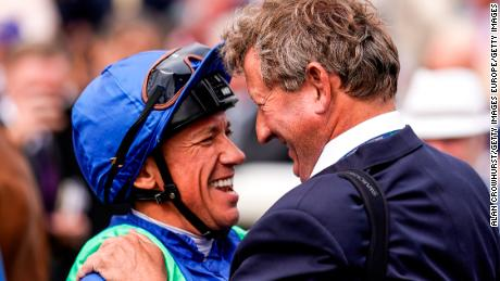 Mark Johnston with Frankie Dettori after winning the race with Poet's Society.