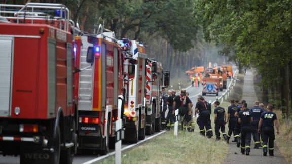 Firefighters arrive to help extinguish a burning section of forest in southern Brandenburg on Friday.