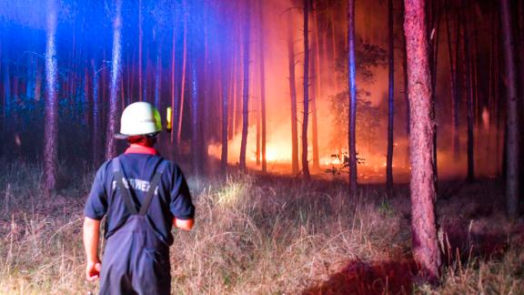 Firefighters battle a wildfire south of Berlin on Friday.