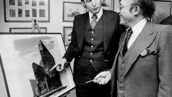 Trump stands with Alfred Eisenpreis, New York's economic development administrator, in 1976 while they look at a sketch of a new 1,400-room renovation project of the Commodore Hotel. After graduating from college in 1968, Trump worked with his father on developments in Queens and Brooklyn before purchasing or building multiple properties in New York and Atlantic City, New Jersey. Those properties included Trump Tower in New York and Trump Plaza and multiple casinos in Atlantic City.