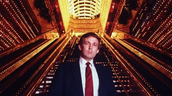 Trump stands in the atrium of Trump Tower.