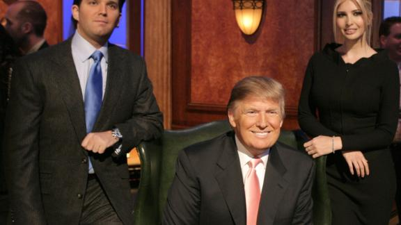 """Trump appears on the set of """"The Celebrity Apprentice"""" with two of his children -- Donald Jr. and Ivanka -- in 2007."""